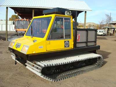 Bombardier BR100 WT, 3-man cab, 4 cyl. gas, 4 sp., 396 hours, front hyd., top rack and custom stake bed cargo area