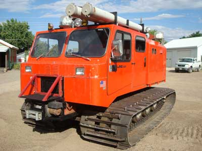 "1987 LMC 1200 series, 5-man cab, 714 hours, rear heater, front 12,000 lb winch, very good 36"" tracks, covered cargo tool box, dual fuel tanks, top racks and tube carriers, nice, clean  machine."